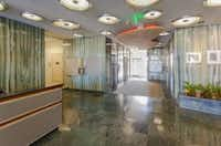 The Meadows Building's 1950s lobby has green polished stone and bubble lights in the ceiling. (Libitzky Property)
