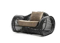Lolah Lounge Armchair in Java by Janus et Cie, handwoven synthetic fiber over a powder-coated steel frame, $3,900, Janus et Cie, 214-712-0003, janusetcie.com