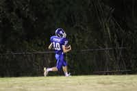 Lakehill student Jack Pippen catches a touchdown pass during an game against Midland Trinity on Oct. 11. Lakehill's Warriors suffered their first loss of the season, with Trinity winning 90-42.