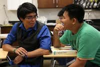 Luis Govea (left), valedictorian of Irving High School, talked to sophomore Jackson Tran during AP chemistry classlast week. (Rose Baca/The Dallas Morning News)
