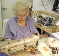 Longtime worker Martha Pinckley, 81, alters a bra for a customer. Her daughter runs the sewing room. The Maddox Shop's legacy goes back about 80 years, and it has been in the Casa Linda Plaza for 54 years.(Kirsten Kearse - Staff Photographer)