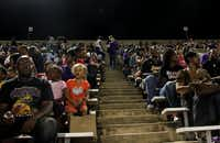 LBJ students and parents watch an LBJ-Reagan football game in Austin, Texas. According to attendees, LBJ and LASA students and parents most often sit in separate sections of the stadium.(Nick Swartsell)