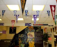 College pennants hang in the hallway at LBJ High School in Austin, Texas.(Nick Swartsell)