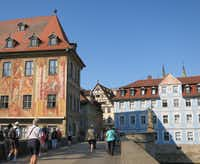 Cruise passengers stroll part of Bamberg's Old Town section. The entire district is declared a UNESCO World Heritage Site. On the left is perhaps the town's most famous secular building, the Old Town Hall with its eye-catching frescoes.