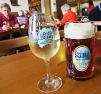 """At the wine- and beer-making Engelberg Monastery, manned by four monks, visitors can enjoy either (or both) libation in the monastery tavern. The tavern was founded in 1916 because as Father Klaus, the monastery superior told me, """"people are also hungry for their stomachs."""" On the glasses, 2006 refers to the year that the monastery celebrated its 600th anniversary as a place of pilgrimage; 1406 refers to the oldest document about this monastery."""