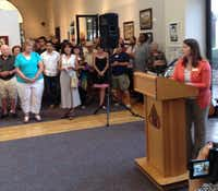 Marcie Inman presents awards in the 13th Annual Art Connection Members Exhibition at the Irving Arts Center.