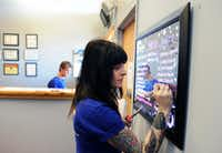 Erika Lindenauer, right, writes down the different varieties of marijuana on the menu board at the Northern Lights Cannabis Co. on Friday, Jan. 24, 2014, in Edgewater near Denver, CO. The store sells both medicinal and recreational marijuana. (Chris Schneider/Special Contributor)(Chris Schneider - Special Contributor)