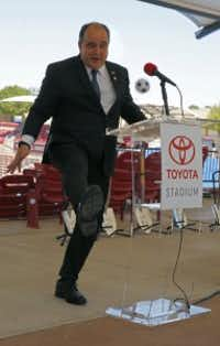Frisco Mayor Maher Maso kicks a toy soccer ball that rolled to the podium during a news conference announcing Toyota Stadium improvements on Thursday. (Nathan Hunsinger/The Dallas Morning News)