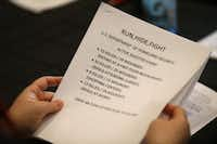 A participant looks through a handout at a training class taught by Dallas Police Officer Dave Wilson at J. Erik Jonsson Central Library on Friday, Dec. 11, 2015. (Jae S. Lee/The Dallas Morning News)