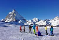 Skiers gather on a slope in Zermatt with the famous Matterhorn in the background. The resort is divided into two ski regions separated by a deep valley.( Photos by Michaela Urban )