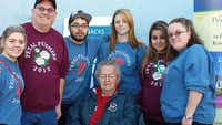 Jordyn McAfee (from left), Kyle McAfee, Jacob Garcia, Brianna Garcia, Patricia Garcia and Teri McAfee surround Teri's father, Roy A. Harzke, for a family photo in Pasadena, Calif., where the family helped to worked on the Roase Bowl parade floats.(Photos submitted by TERI McAFEE)