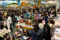 "Fans wait for author Stephenie Meyer and cast members of ""The Host"" to arrive at the Barnes & Noble on Northwest Highway in Dallas on Tuesday, March 12, 2013."