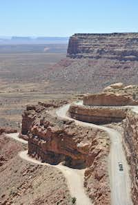 Only vehicles less than 28 feet and 10,000 pounds should attempt the tight switchbacks of the Moki Dugway in Utah, which overlooks Valley of the Gods to the southeast and Monument Valley, farther away to the southwest.