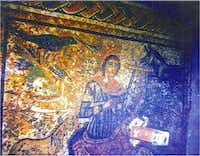 Orpheus mosaic in situ. This photograph was provided by the Şanlıurfa Prosecutor's Office. It is evidence in a criminal prosecution within Turkey against looters. The mosaic's border is visible in this photograph; it was missing when the DMA purchased the mosaic, presumably removed by looters because it was incomplete.  The canister visible to the lower right contains a Turkish brand of glue, which looters — not archaeologists —would have used to make repairs.