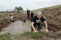 Participants in the Original Mud Run make their way through a mud pit during the event in Fort Worth on Saturday, April 14, 2012.