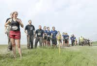 Participants in the Original Mud Run wait, not so patiently, for others to cross the Trinity River on April 14, 2012.