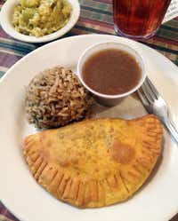 The main attraction at Lasyone's Meat Pie Restaurant in Natchitoches, La.: a meat pie, Cajun dirty rice and gravy.