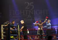Boxer Jas Phipps was announced as the split-decision winner of the opening bout at FightNight 25 at the Hilton Anatole Hotel in Dallas on Thursday night. The event is an eclectic combination of drinking, eating, celebrity-gazing, smoking, gambling and World Boxing Council-sanctioned matches.