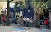 Patrons enjoy lunch on the back patio of Gloria's Restaurant in the Village on the Parkway shopping center.