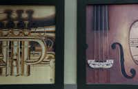 Murals of musical instruments are painted on the sides of storefronts in the Village on the Parkway shopping center.