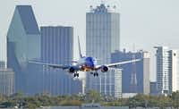 Federal officials hope the settlement of the American-US Airways merger lawsuit will boost competition from carriers such as Southwest Airlines.