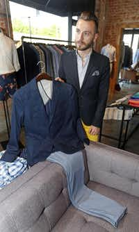 <bold>Guide Jason Bagby</bold> shows a customer how a blazer and pants look together at online retailer Bonobos' new Dallas shop.Michael Ainsworth - Staff Photographer