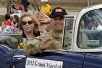 Candice Nelson, Elise Nelson, 3, and Capt. Tim Nelson greeted the crowd in Frisco at a community parade.