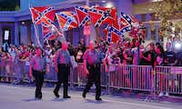 Demonstrators with Confederate battle flags greet President Barack Obama's motorcade as it arrives to his hotel in Oklahoma City, the evening of July 15, 2015. (Doug Mills/The New York Times)