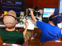 Two boys broadcast signals during the Irving Amateur Radio Club's Field Day in June. The group also participates in Hamfest in March, the Fourth of July parade and assists in severe weather and emergencies.( Photos submitted by the IRVING AMATEUR RADIO CLUB )