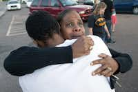 "Shamecca Davis hugs her son Isaiah Bow, an eyewitness to the massacre at a screening of the new Batman movie, ""The Dark Knight Rises"" in Aurora, Colo."