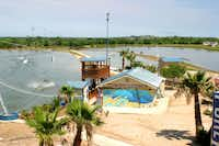 Texas Ski Ranch features three lakes for active water sports. In one lake, boats tow skiers, or wakeboarders can hang to a cable that pulls them 19 mph around another lake. For kids or beginners, there's a practice lake with slower cables.