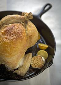 Roast a  whole chicken in a cast-iron pan with a few simple ingredients, including lemon.(G.J. McCarthy - Staff Photographer)