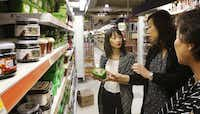 Cheryl Collett, Hyejon Ko-Suk and Lisa Shin shop at H Mart in Korean town in Carrollton.(Lawrence E. Jenkins - Special Contributor)