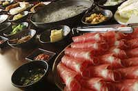 "The table is set for a Korean favorite: ""Shabu shabu is what I call festive food,"" says restaurateur Sammantha Kang. ""It is eaten slowly and encourages gathering and communion.""( Lawrence E. Jenkins  -  Special Contributor )"