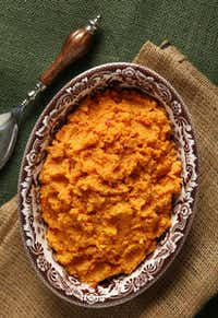Sorghum Sweet Potatoes add a taste of New Southern Thanksgiving to the table. Serving dish and spoon from Suzanne Roberts.