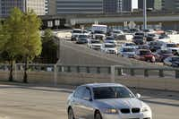 A look at traffic along Woodall Rogers headed north on US 75 on the north side of downtown Dallas, Texas on Tuesday, October 8, 2013.