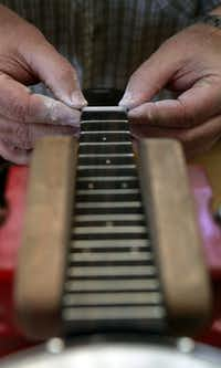 Morris worked on an instrument recently in his workshop. He says they use premium and exotic woods in their banjo ukes.