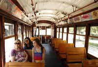 (L-R) Janice Agee from Irving, Linda Burkhart of Dallas and Kelly McGinnis from Brookhaven, Mississippi check out the sights on the McKinney Avenue Trolley in Dallas, Texas on Wednesday, August 29, 2012.