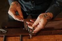 Phillips' tattooed hands look like a sketchbook on skin.