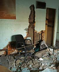 An old office chair and other debris sit in what was the front office of the Mission Motel. The motel was once a popular roadside accommodation for travelers along the former turnpike between Dallas and Fort Worth.( Staff photo by G.J. McCarthy   -  DMN )
