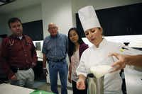 Chef Zoe Muller (right) prepares a strawberry and banana smoothie for cancer patient Kevin McKool (center) as oncology dietician Louise Chen and doctor Brian Berryman (left) watch on Wednesday, Sept. 12, 2012 at the Baylor University Medical Center at Dallas. Muller and Chen wanted to recommend options for healthy foods for cancer patients. (Katie Currid/The Dallas Morning News)Katie Currid