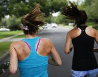 Marla Sewall goes on a run with her exercise partner Kristin Emerson (right) around their neighborhood near University Park.