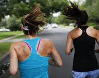 Marla Sewall goes on a run with her exercise partner Kristin Emerson (right) around their neighborhood near University Park.