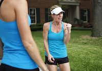 Marla Sewall recounts a story to exercise partner Meridith Sexton (left) of a man in Walgreens who recognized her from the news and very excited about her recovery before a run in her neighborhood on Thursday, Sept. 13, 2012 in Dallas. Sewall had a sudden heart attack and was found dead by her husband, who resuscitated her and saved her life.