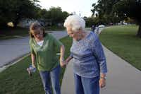 Kathy Hill (left) helps her mother, Charlotte Davis, off the path.