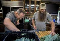 Stephen Smith  (left) and James Jeffers grow kale and other produce on a farm in DeSoto. Farmers Assisting Returning Military strives to help military veterans and, hopefully, decrease veteran suicides.(Photos by G.J. McCarthy - Staff Photographer)
