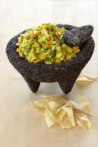 Make and serve authentic guacamole using a lava-rock molcajete from Imusa. $59.99 at Macy's.Imusa