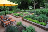 The backyard of Lisa Domiteaux and her husband Mark features order raised vegetable beds, a custom chicken habitat, a pond with water lilies, and garden beds., Monday, April 30, 2012.Steve Pfost / The Dallas Morning News