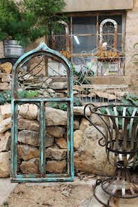 Salvaged decorative elements in a historic stone building provide the backdrop for plants at Seymour's Feed and Seed Barn.Feed and Seed Barn