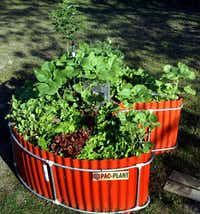 Though small, keyhole gardens can provide big, almost year-round harvests of fresh vegetables. This one at keyholefarm.com has a variety of lettuces, herbs and vegetables.Keyholefarm.com